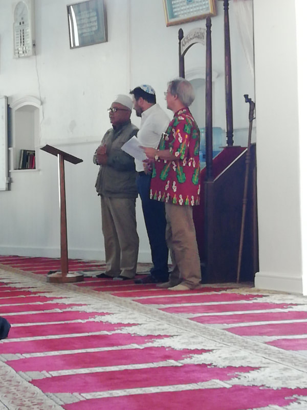 At Al-Azhar Mosque in District 6, Sheikh Ismail Keraan introduces Stuart Diamond of the jewish faith and Bishop Augustine Joemath of the nearby Moravian Church